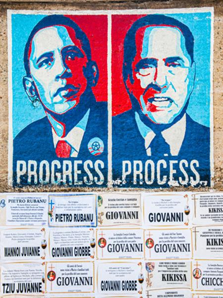Pintura mural donde vemos a Obama con un rótulo que pone Progress y a Berlusconi con otro rótulo que pone Process. Orgosolo. Cerdeña.