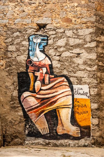 Pintura mural que representa a Elisabetta Lovico de Orgosolo. Orgosolo. Cerdeña.